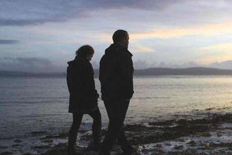 (FOR FUTURE PROJECT. DO NOT PUBLISH.) Galway, Ireland, 11/2016, Vincent Doyle, right, and Sarah Thomas, walk the beach at Galway Bay near his home. Doyle is the child of a priest and has launched a website called Coping International and has created a community of children of priests, including Thomas, who visits him from her London home. (Suzanne Kreiter/Globe staff)