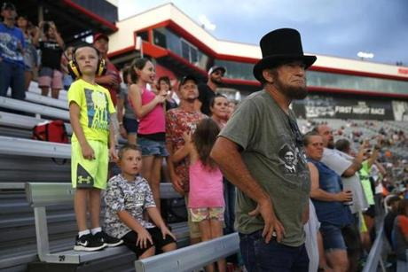 Bristol, TN -- 8/18/2017 - Warren Denney, a professional Abraham Lincoln impersonator, wore his hat as he stood to watch the cars take off for the Bass Pro Shops NRA Night Race Qualifying Race. (Jessica Rinaldi/Globe Staff) Topic: 21NASCAR Reporter: Annie Linskey