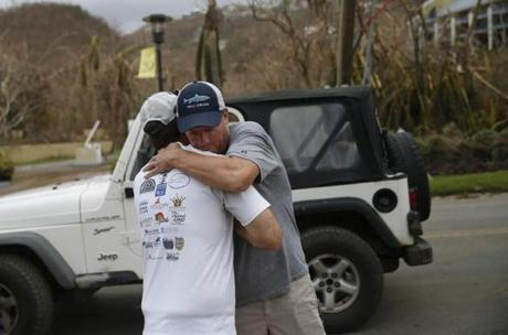 Great Cruz Bay, St. John -- 9/14/2017 - Rob Woodworth (R) who owns Sunshine Daydream Boat Charters embraces Robert Gonzales after seeing each other for the first time since Hurricane Irma hit on St. John. (Jessica Rinaldi/Globe Staff) Topic: Reporter: