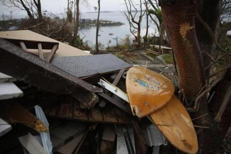Cruz Bay, St. John -- 9/14/2017 - Surf boards are seen in the debris from Hurricane Irma, at Estate Lindholm a hotel in the Cruz Bay section of St. John. (Jessica Rinaldi/Globe Staff) Topic: Reporter: