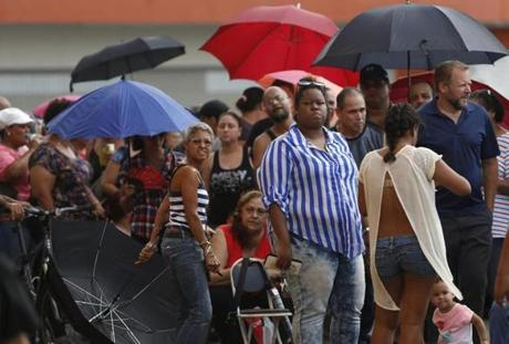 Hundreds of people waited for the ATM at a bank in Caguas.
