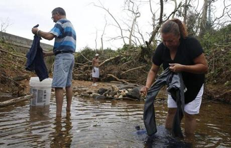 Elizabeth Nieves and Carlos Hernandez washed clothes in a river.