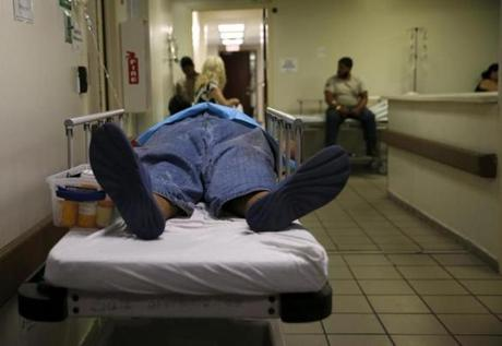 Caguas, Puerto Rico -- 9/29/2017 - A patient lays in a hospital bed in the hallway inside the emergency room at HIMA San Pablo Hospital in Caguas. (Jessica Rinaldi/Globe Staff) Topic: Reporter: