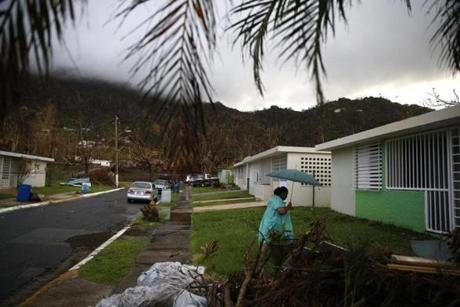 Yabucoa, Puerto Rico -- 9/29/2017 - Carmen Charriez, 71, walks across the street to the home they are moving into in Yabucoa. (Jessica Rinaldi/Globe Staff) Topic: Reporter: