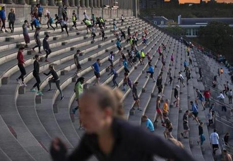 6:18 a.m.: Before sunrise, the Stadium stairs are alive with people.