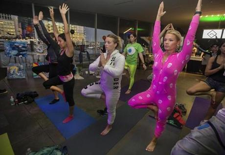 6:40 a.m.: Sarah Somogie (right) is up bright and early for yoga at the Daybreaker event.