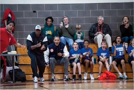 The president at one of daughter Sasha's basketball games in February 2011.