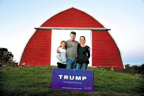Matt Jansen (center), his wife, Andrea, and their daughter, Maggie, at their family-run farm in New Salem, Pa. Matt won a spot as a Trump delegate at the Republican National Convention.