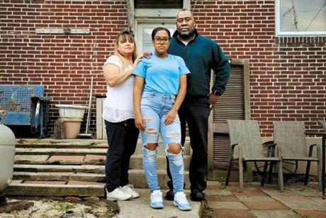 Nylaya Way (center), 16, a junior at York County School of Technology, with her parents, Barbara Estep and Steve Way, at their home in York.