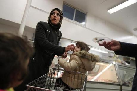 NOT FOR GETTY. Norwood, MA., 01/26/17, One week after arriving from Syria via Jordan, six days after President Trump's Inauguration, Asmaa Hayani, fearful and uncertain, is taken to a halal market in suburban Boston by a volunteer. Suzanne Kreiter/Globe staff