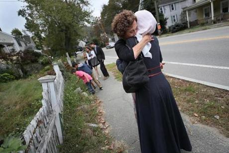 NOT FOR GETTY. Wellesley, MA., 09/30/17, Asmaa Hayani gets a strong hug from volunteer Bonnie Rosenberg as they walk to Temple Beth Elohim on Yom Kippur. Suzanne Kreiter/Globe staff
