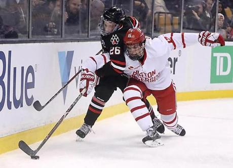 Northeastern Biagio Lerario got a defensive pressure from BU Chase Phelps during second period.