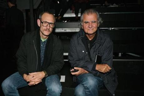Photographers Terry Richardson, left, and Patrick Demarchelier pose for photographers, on arrival at the Saint Laurent Spring-Summer 2016 ready-to-wear fashion collection, presented during the Paris Fashion Week in Paris, Monday Oct. 5, 2015. (AP Photo/Zacharie Scheurer)