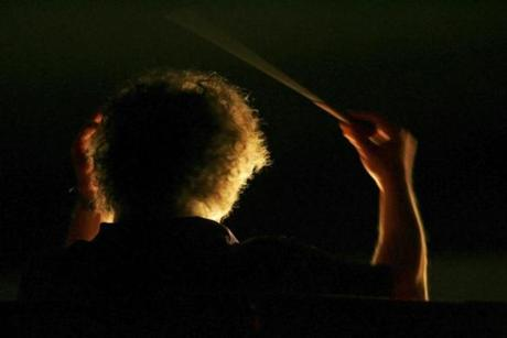 FILE -- A backlit James Levine conducts the Metropolitan Opera Orchestra during a dress rehearsal for its 125th anniversary gala, in New York, March 13, 2009. In light of accusations by several men that Levine sexually abused them when they were teenagers, what is to become of the legacy of this towering American artist, and the admiration by fans of his work? (Ruby Washington/ The New York Times)
