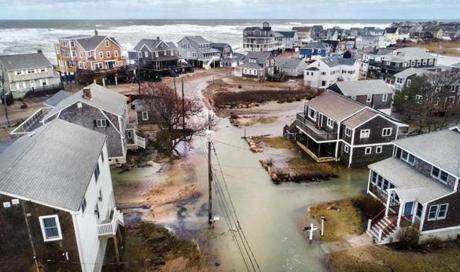 On March 5, seawater made streets impassable in this Oceanside Drive neighborhood in Scituate during high tide.