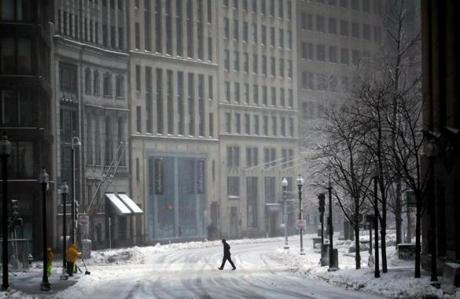 A person walked on an empty Congress Street in Boston's Financial District.