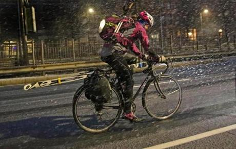 A bicyclist braved the snow on Commonwealth Avenue in Boston.