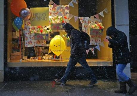 Pedestrians passed a spring window display on Boylston Street in Boston.