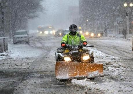 A small plow cleared Berkley Street in Boston during the storm.