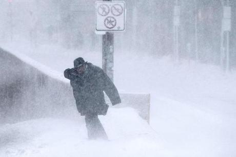 Boston, MA - 3/13/2018 - A man walks through a storm that is expected to leave up to two feet of snow in Boston, MA, Mar. 13, 2018. (Keith Bedford/Globe Staff) snow storm nor'easter blizzard