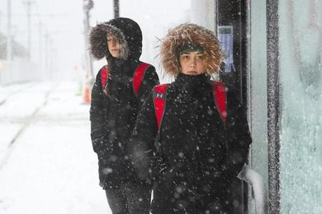 Boston University students Brooke Jones and Samantha Simonetti, both Boston University dance team members, waited in the storm for a train on Commonwealth Avenue for a ride to rehearsal on Tuesday.