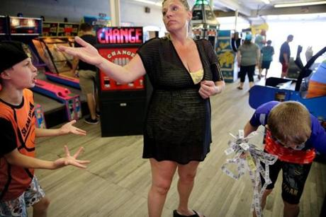 "Hampton Beach, NH- July 12, 2017: Will Biscan, 11, left, complained to his mother, Roberta Biscan, after she gave her winnings of 250 tickets to his brother, Connor Biscan, 13, while visiting the Playland Arcade at Hampton Beach, N.H,. last July. Will, who used to share a bedroom with Connor, has struggled with his brother's autism diagnosis. ""Will feels that Connor gets a lot more than he does,'' his mother said. ""Will knows what triggers Connor, he doesn't like Connor's behavior but a lot of times he'll instigate it."" (Craig F. Walker/Globe Staff) section: metro reporter: kowalczyk"