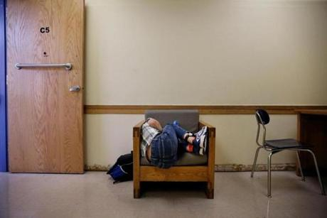 Southborough, MA- September 13, 2017: Connor Biscan, 13, curled up to watch a video on his iPad in his classroom at the New England Center for Children in Southborough last September. IPad time is a reward for good behavior. The school practices applied behavior analysis, a type of behavior modification that breaks down desirable conduct into steps and rewards children for completing each step. First, teachers used rewards to get Connor to ask politely for his device. The demands gradually increased. (Craig F. Walker/Globe Staff) section: metro reporter: kowalczyk