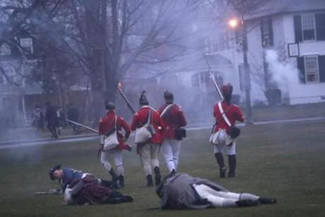 "April 16, 2018 LEXINGTON, MA - Many memebers of the Lexington militia lay wounded and dead as they battle with the King's Regulars during the re-enactment of the ""Battle of Lexington"" on the Lexington Common to commemorate the 243rd Anniversary of the first day of the American Revolutionary War. (Joanne Rathe/ Globe Staff)"