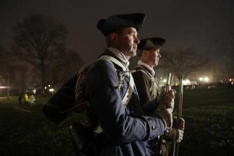 April 16, 2018 LEXINGTON, MA - Two newest members of the Lexington Minute Men, twin brothers, who are participating in their first reenactment. twin brothers, Dan and Dave Gibson, wait in pre dawn hour for battle to begin. (Joanne Rathe/ Globe Staff) April 16, 2018