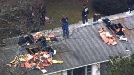 Police officers searched on the roof of the house where the shooting of Sean Gannon allegedly took place.