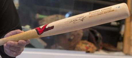 This is Johnny Gomes's Boston Strong bat with the names of the four people who died in connection with the Boston Marathon bombings.
