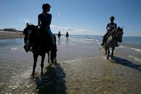 Magazine Best Beaches - Sandwich/Barnstable , MA- July 05, 2017: Nicoletta Agostina, left, and Sara Fritze , left, joined a tour led by Caitlin Bennelli of Esperanza Riding Company leads a tour on Sandy Neck Beach in Barnstable , MA on July 05, 2017. (CRAIG F. WALKER/GLOBE STAFF) section: metro reporter: