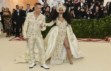 Jeremy Scott, left, and Cardi B attend The Metropolitan Museum of Art's Costume Institute benefit gala celebrating the opening of the Heavenly Bodies: Fashion and the Catholic Imagination exhibition on Monday, May 7, 2018, in New York. (Photo by Charles Sykes/Invision/AP)