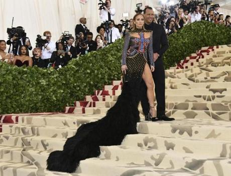 Jennifer Lopez, left, and Alex Rodriguez attend The Metropolitan Museum of Art's Costume Institute benefit gala celebrating the opening of the Heavenly Bodies: Fashion and the Catholic Imagination exhibition on Monday, May 7, 2018, in New York. (Photo by Charles Sykes/Invision/AP)