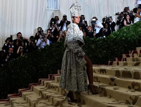 Rihanna arrives for the 2018 Met Gala on May 7, 2018, at the Metropolitan Museum of Art in New York. The Gala raises money for the Metropolitan Museum of Arts Costume Institute. The Gala's 2018 theme is Heavenly Bodies: Fashion and the Catholic Imagination. / AFP PHOTO / Hector RETAMALHECTOR RETAMAL/AFP/Getty Images