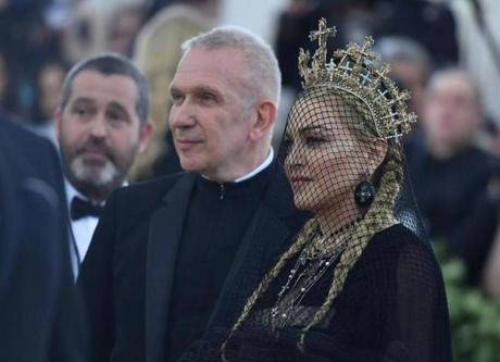 French Designer Jean-Paul Gaultier and Madonna arrive for the 2018 Met Gala on May 7, 2018, at the Metropolitan Museum of Art in New York. The Gala raises money for the Metropolitan Museum of Arts Costume Institute. The Gala's 2018 theme is Heavenly Bodies: Fashion and the Catholic Imagination. / AFP PHOTO / Angela WEISSANGELA WEISS/AFP/Getty Images