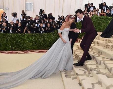 Hailey Baldwin (L) and Shawn Mendes arrive for the 2018 Met Gala on May 7, 2018, at the Metropolitan Museum of Art in New York. The Gala raises money for the Metropolitan Museum of Arts Costume Institute. The Gala's 2018 theme is Heavenly Bodies: Fashion and the Catholic Imagination. / AFP PHOTO / Hector RETAMALHECTOR RETAMAL/AFP/Getty Images