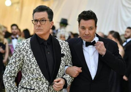 Stephen Colbert (L) and Jimmy Fallon arrive for the 2018 Met Gala on May 7, 2018 at the Metropolitan Museum of Art in New York. The Gala raises money for the Metropolitan Museum of Arts Costume Institute. The Gala's 2018 theme is Heavenly Bodies: Fashion and the Catholic Imagination. / AFP PHOTO / Angela WEISSANGELA WEISS/AFP/Getty Images