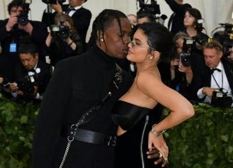 Kylie Jenner (R) and Travis Scott arrive for the 2018 Met Gala on May 7, 2018, at the Metropolitan Museum of Art in New York. The Gala raises money for the Metropolitan Museum of Artââ¬â¢s Costume Institute. The Gala's 2018 theme is ââ¬ÅHeavenly Bodies: Fashion and the Catholic Imagination.ââ¬ï¿½ / AFP PHOTO / Angela WEISSANGELA WEISS/AFP/Getty Images