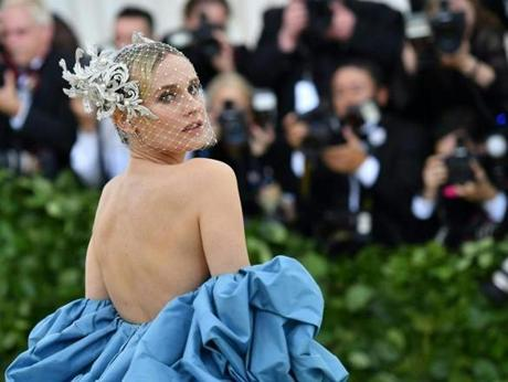 Diane Kruger arrives for the 2018 Met Gala on May 7, 2018, at the Metropolitan Museum of Art in New York. The Gala raises money for the Metropolitan Museum of Arts Costume Institute. The Gala's 2018 theme is Heavenly Bodies: Fashion and the Catholic Imagination. / AFP PHOTO / Angela WEISSANGELA WEISS/AFP/Getty Images