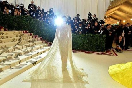 Rosie Huntington-Whiteley arrives for the 2018 Met Gala on May 7, 2018, at the Metropolitan Museum of Art in New York. The Gala raises money for the Metropolitan Museum of Arts Costume Institute. The Gala's 2018 theme is Heavenly Bodies: Fashion and the Catholic Imagination. / AFP PHOTO / Angela WEISSANGELA WEISS/AFP/Getty Images