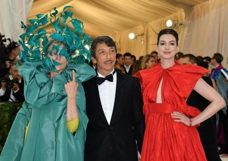 (L-R) Frances McDormand, Pierpaolo Piccioli, and Anne Hathaway arrive for the 2018 Met Gala on May 7, 2018, at the Metropolitan Museum of Art in New York. The Gala raises money for the Metropolitan Museum of Arts Costume Institute. The Gala's 2018 theme is Heavenly Bodies: Fashion and the Catholic Imagination. / AFP PHOTO / Angela WEISSANGELA WEISS/AFP/Getty Images