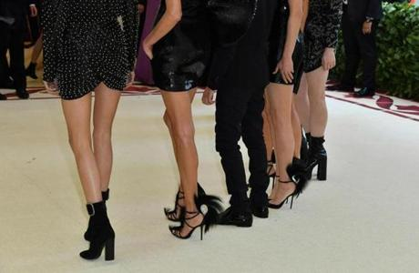 (R-L) Mica Arganaraz, Anja Rubik, Anthony Vaccarello, Amber Valletta, Kate Moss, Charlotte Casiraghi and Charlotte Gainsbourg arrive for the 2018 Met Gala on May 7, 2018, at the Metropolitan Museum of Art in New York. The Gala raises money for the Metropolitan Museum of Arts Costume Institute. The Gala's 2018 theme is Heavenly Bodies: Fashion and the Catholic Imagination. / AFP PHOTO / Angela WEISSANGELA WEISS/AFP/Getty Images