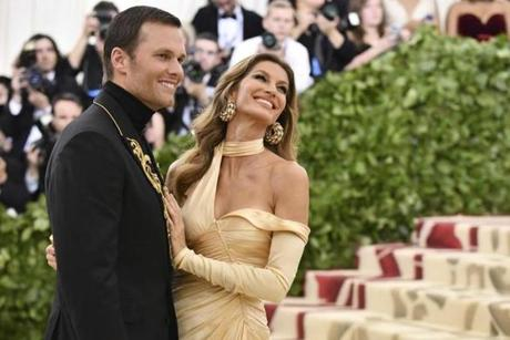 Tom Brady, left, and Gisele Bundchen attend The Metropolitan Museum of Art's Costume Institute benefit gala celebrating the opening of the Heavenly Bodies: Fashion and the Catholic Imagination exhibition on Monday, May 7, 2018, in New York. (Photo by Charles Sykes/Invision/AP)