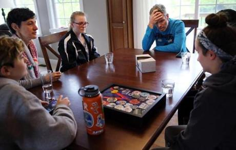 Relatives and friends shared memories of Alexandra at the Valoras home. From left are Emily Valoras, Alysia Valoras, Ashley Hamilton, 18, Dean Valoras, and Emily Weagle, 17. Hamilton and Weagle were on the robotics team with Alexandra.