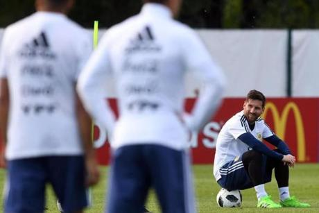 Argentina's forward Lionel Messi smiles as he sits on a ball during a training session of Argentina's national football team at the team's base camp in Bronnitsy, near Moscow, on June 11, 2018 ahead of the Russia 2018 World Cup football tournament. / AFP PHOTO / Francisco LEONGFRANCISCO LEONG/AFP/Getty Images