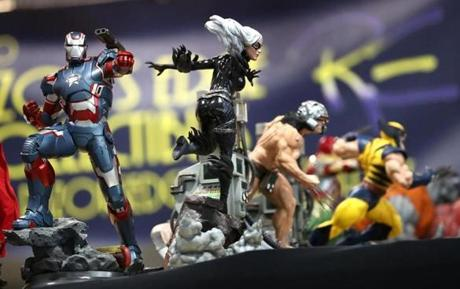 Models of superheros (from left) War Machine, Black Cat, and Weapon X on display.