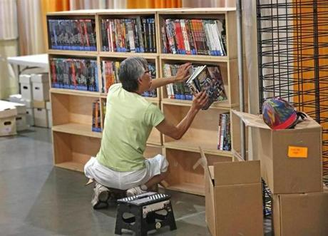 Tom Yee packed comic books on a shelf while setting up Thursday for Fan Expo Boston, which will stretch across 250,000 square feet of space in the convention center.