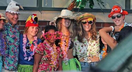Boston, MA: 8-9-18: Jimmy Buffett performed at Fenway Park tonight. Fans were dressed for the occasion as they posed on a sidewalk before heading into the park. (Jim Davis/Globe Staff)