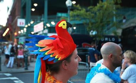 Boston, MA: 8-9-18: Jimmy Buffett performed at Fenway Park tonight. Fans were dressed for the occasion, this one with a parrott head, as they headed to the park. (Jim Davis/Globe Staff)